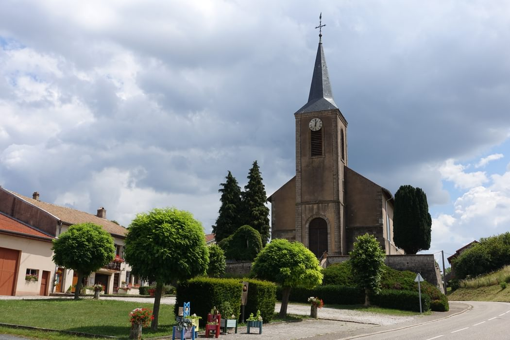 Church in Fribourg (Lorraine) with children's gardening projects
