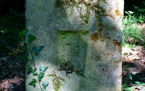 Eastern side of old border stone (with D for Deutschland effaced)