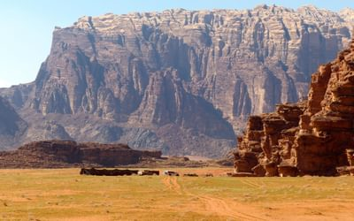 Jebel Rum towers above a Bedouin Camp in Wadi Rum