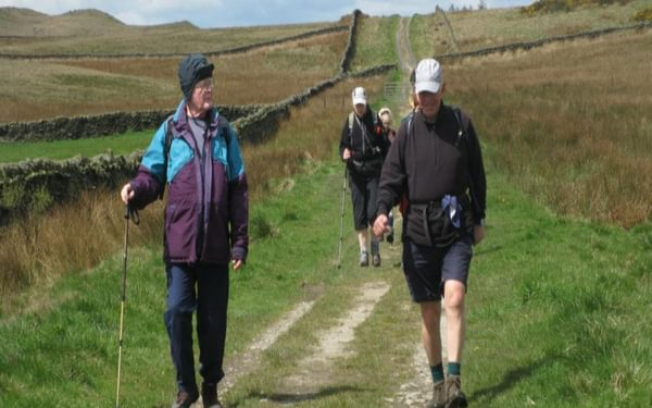 Walkers on the prehistoric track over Skipton Moor
