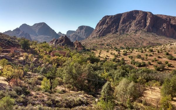 The valley is known as 'Samazar' to climbers and is listed as such on many maps. The first climber to descend it mistook the pronunciation (Samazar for Tamza) indicating how hard it is to get an exact translation from Berber dialect