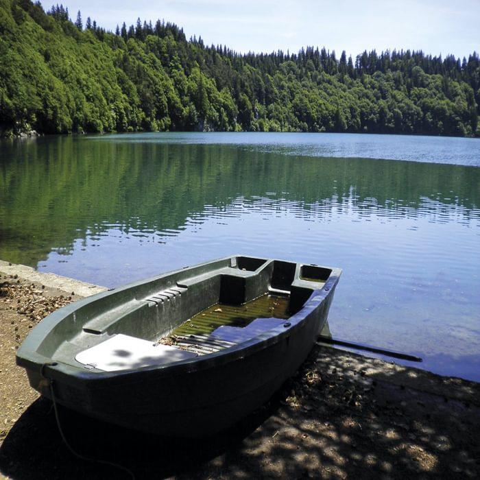 Leaky boat moored at Lake Pavin