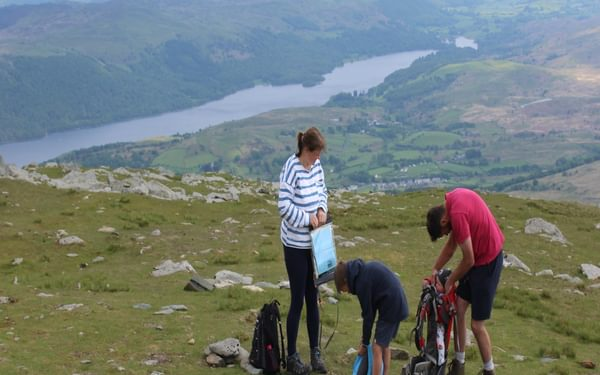 Babies can be remarkably portable. Getting back in the carrier on the summit of the Old Man of Coniston