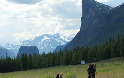 8 The hay meadows at Aktse with Skierffe's steep face as a backdrop.