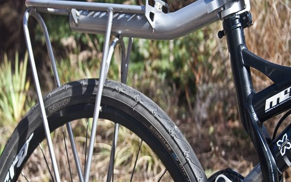 A rack that clamps on to a metal seat post may be required if your bike does not have rack lugs or has rear suspension (Image by Richard Barrett)