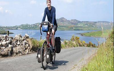 Cicerone author Tom Cooper riding with a  full set of panniers (Image by Tom Cooper)