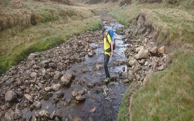 Challenger Elton from Grimsby crosses the burn by Shielin of Mark bothy