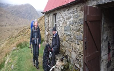 Challenger Viv from Altrincham arrives at Camban bothy just as the first afternoon turned to rain