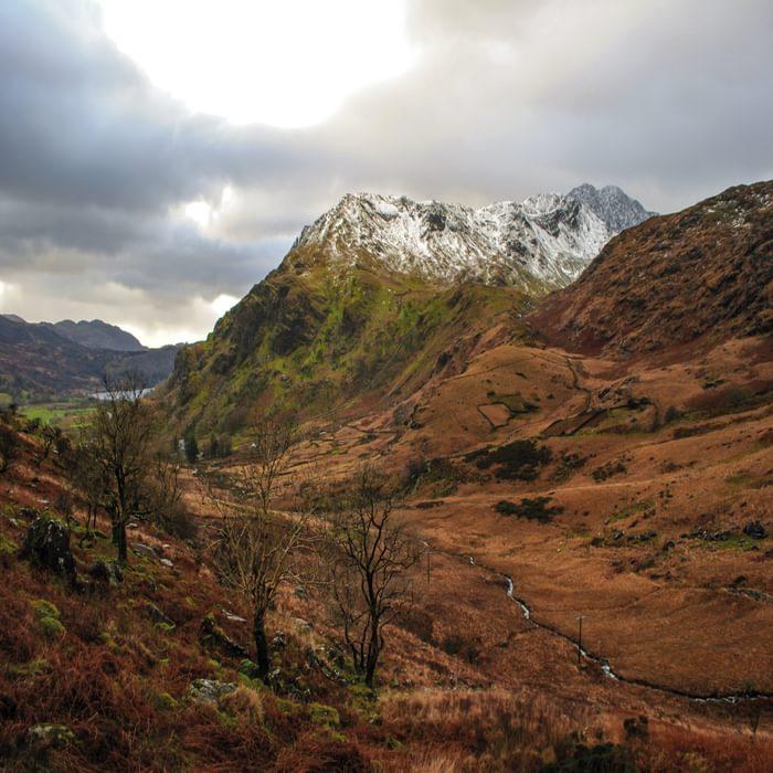 The Snow Covered Peak Of Y Lliwedd Rising Above Nant Gwynant