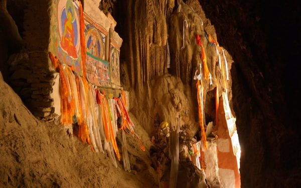 Chungsi's cave, filled with hundreds of statues and stuffed with prayer-flags