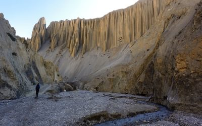 The fairy-style eroded rockface overlooking the river near Yara houses dozens of caves