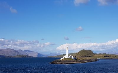The lighthouse on Eilean Musdile from the ferry crossing to Mull