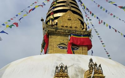 A stupa in Kathmandu. You can purchase buckets of white paint as an offering and these are then thrown over the stupa from the top of the dome.