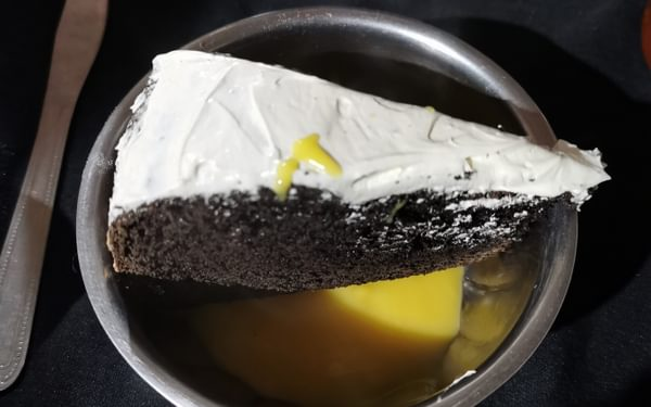 Cake and custard, cooked (somehow) over a campfire
