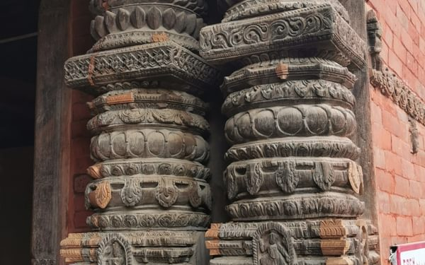 The handcarved detail on the sacred buildings in Durbar Square. Note the pale patches which are recently carved pieces to repair the earthquake damage. An enormous undertaking.