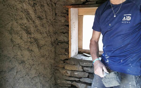 David plastering the walls of the toilet block