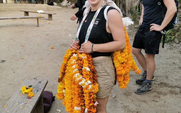 Sarahann prepares to carry our marigold collection back to the campsite - it was quite heavy!