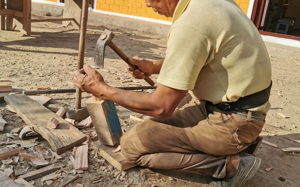 The carpenter making another hammer