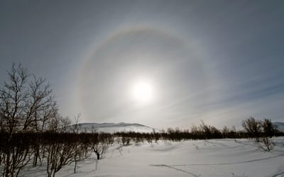 An incredible Norwegian landscape, complete with a halo around the sun