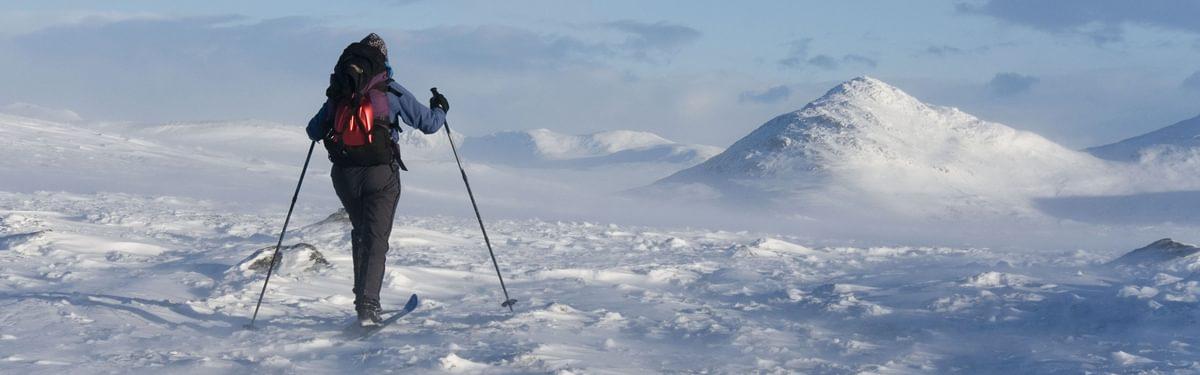 skiing across snow