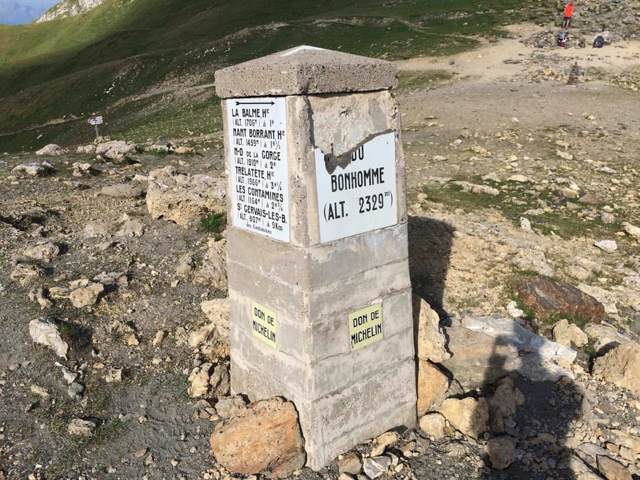 A Chipped Sign Marking The  Col Du  Bonhomme