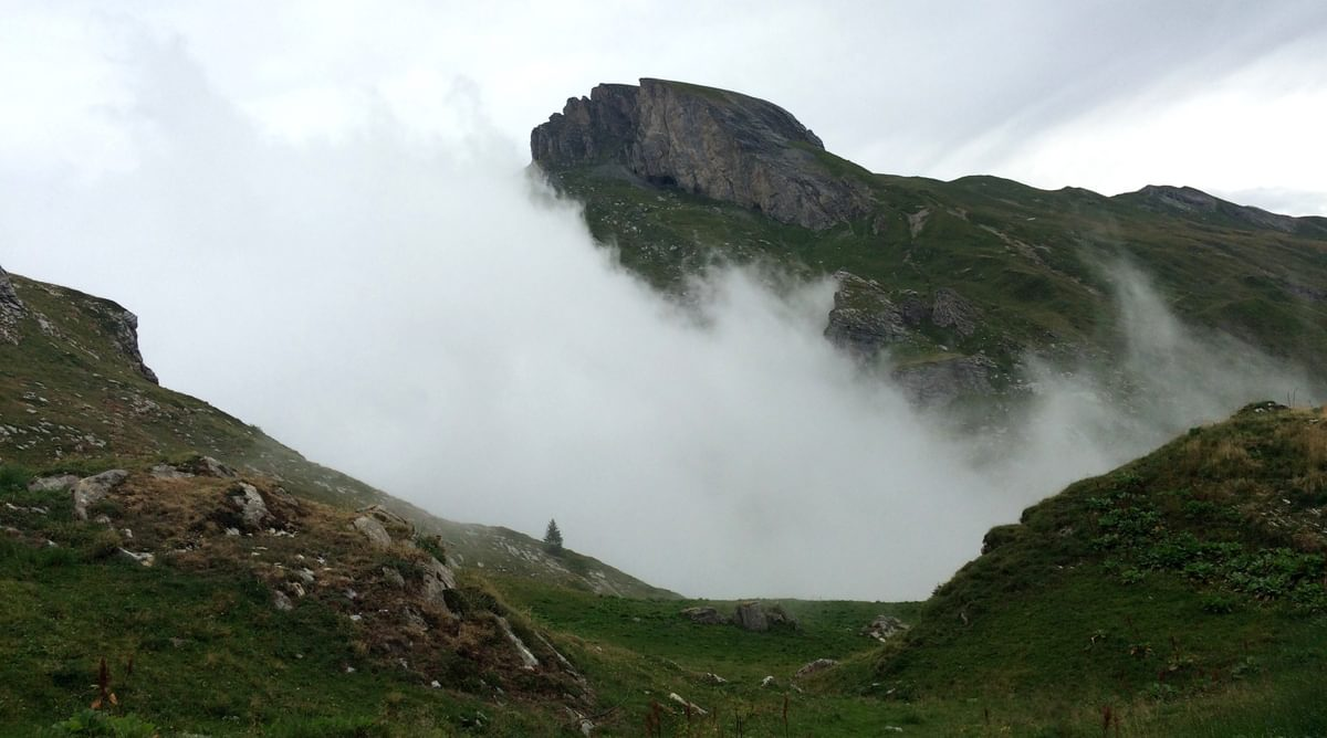 The Clouds Which Threatened Bad Weather All Day Fall Into The Mountains In The Afternoon