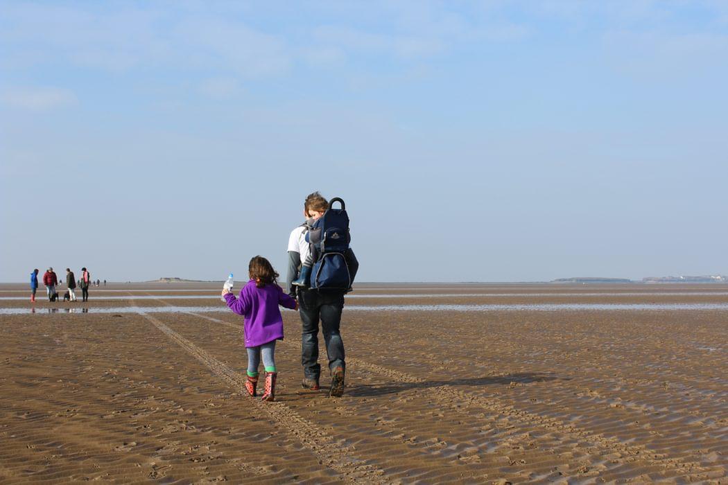 children walking to Hillbre island