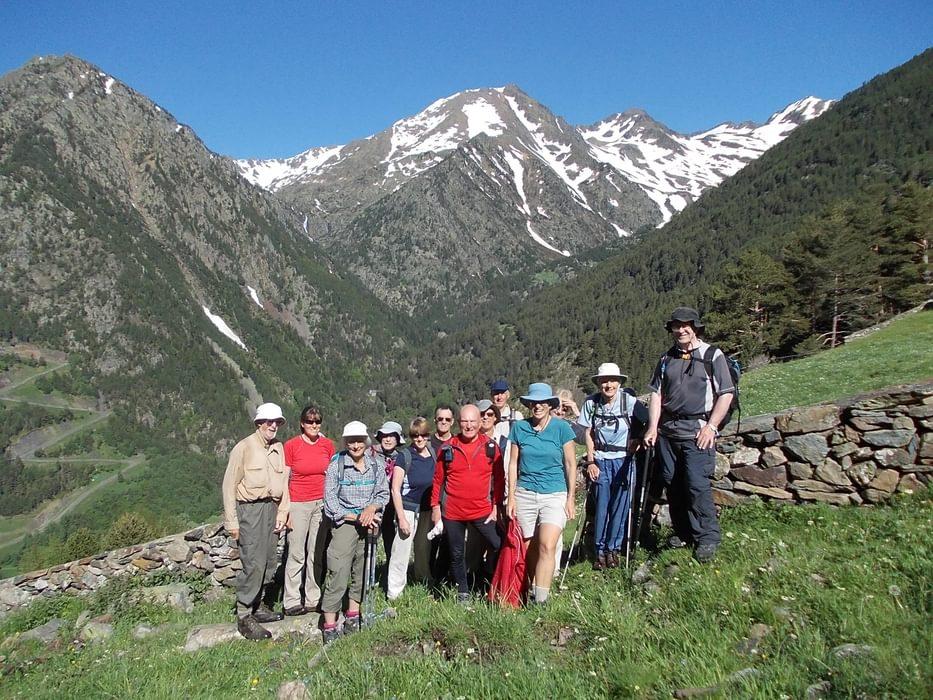 A happy rambling group in Andorra with Pic de la Coma Pedrosa behind