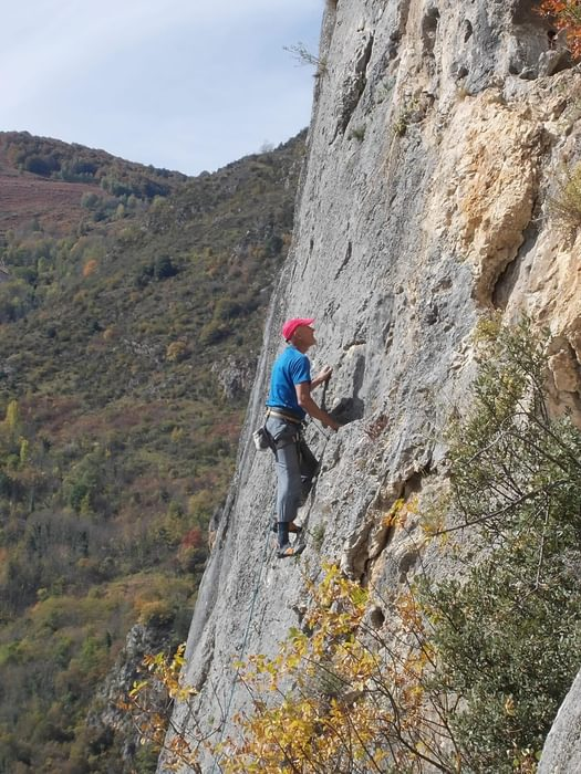 The author enjoying a fine day out sport climbing on the local crags at Sinsat