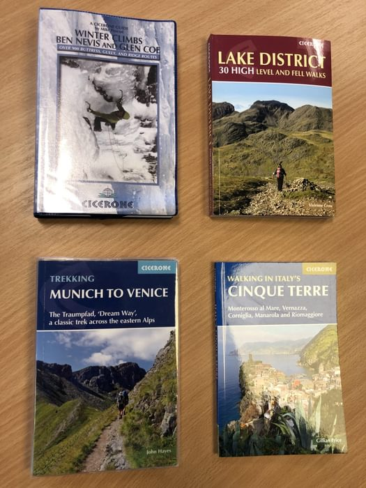 Different types of protective covers on Cicerone guidebooks: (clockwise from top left) encapsulated PVC, flaps, laminated paperpack, PVC sleeve