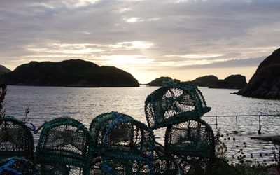 Lobster nets at the tiny harbour of Tarbet