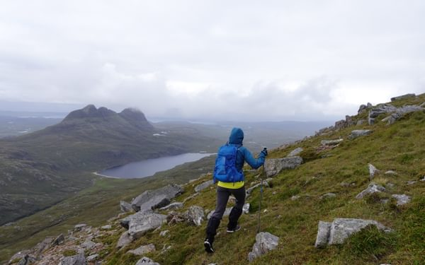 Nearing the summit of Canisp Suilven lies across Loch na Gainimh