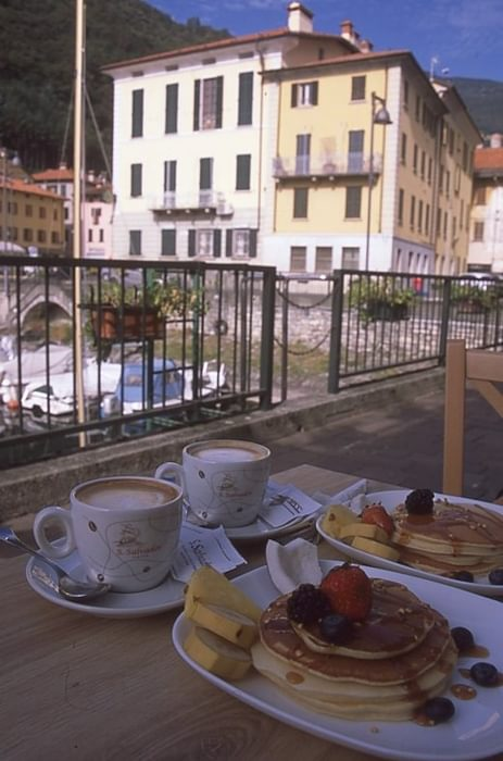 Enjoying breakfast of Italian coffee and pancakes