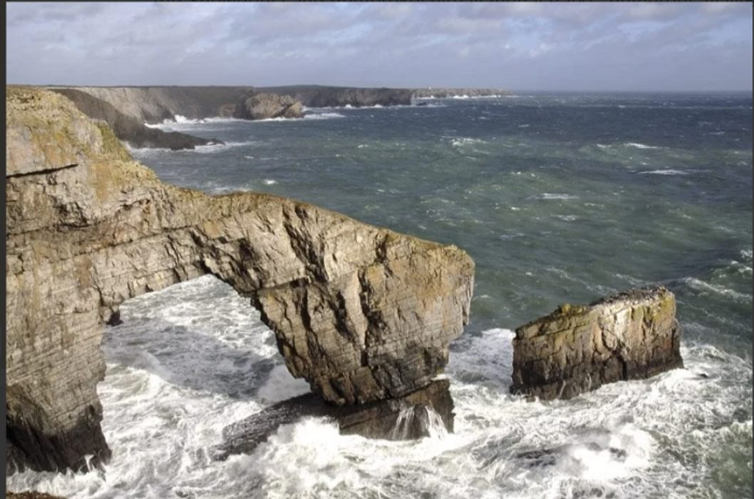The green Bridge of Wales in Pembrokeshire gets pounded by the sea