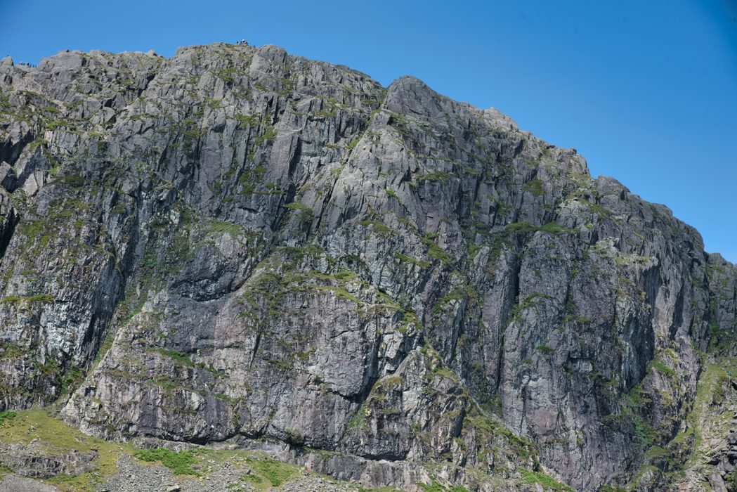 the face of Pavey Ark above Stickle Tarn.  Jack's Rake takes the obvious right to left rising traverse across the face.