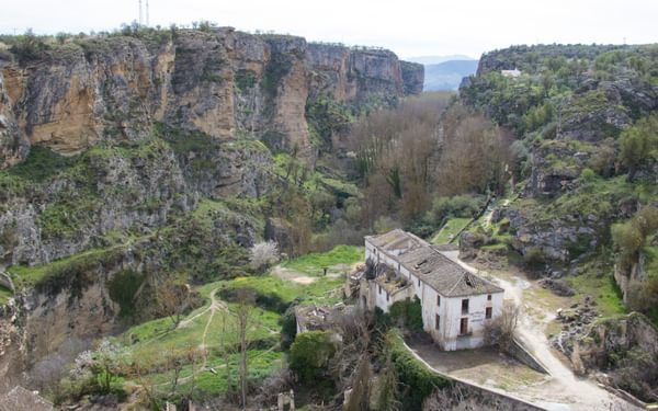 The ruins of one of the five disused flour mills in the Alhama de Grenada gorge