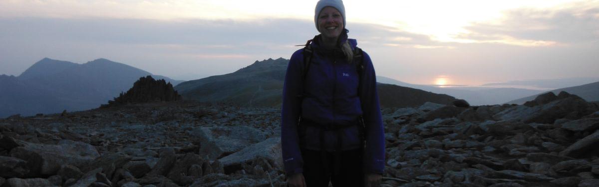 Ali Near The Summit Of Glyder Fach As The Sun Falls Into The Sea