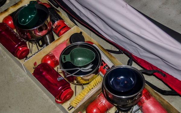 Custom-made kitchen boxes to safely cook in the front portion of the tent.