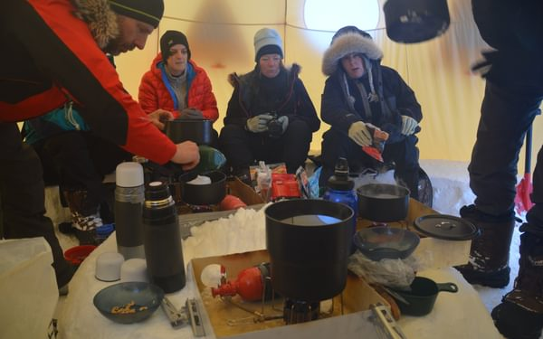 A communal (bigger) tent brings everyone together to exchange experiences and ideas. Humour is usually served along with hot drinks and basic, but oh-so welcome food to keep our internal fire going.