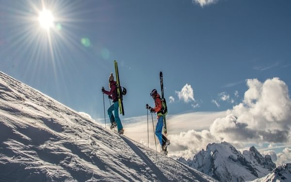 Ascending the final ridge of Piz Boe with superb views over the Marmolada