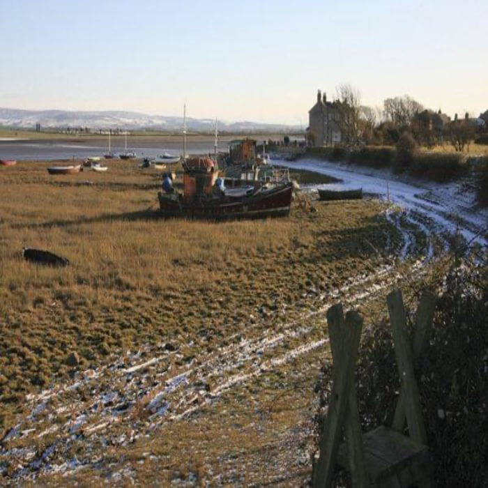 Beached boats indicate that the high tide covers the salt marshes at Sunderland Point (Walk 40)