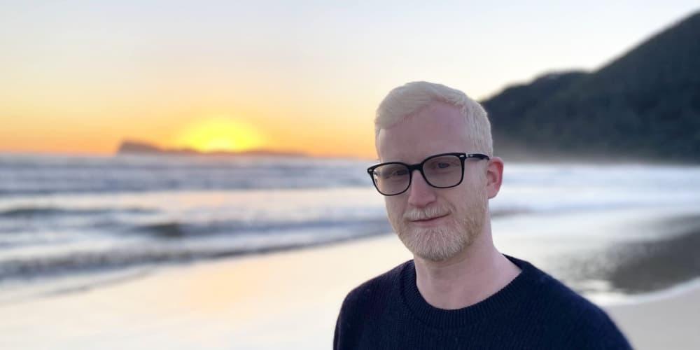 Full Stack Engineer Jamie King of ezyVet at beach