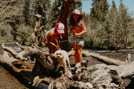 My two daughters and our dog, Maggie, hanging out at the river