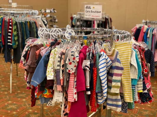 A rack of girls' clothing at a River Bend Kids resale