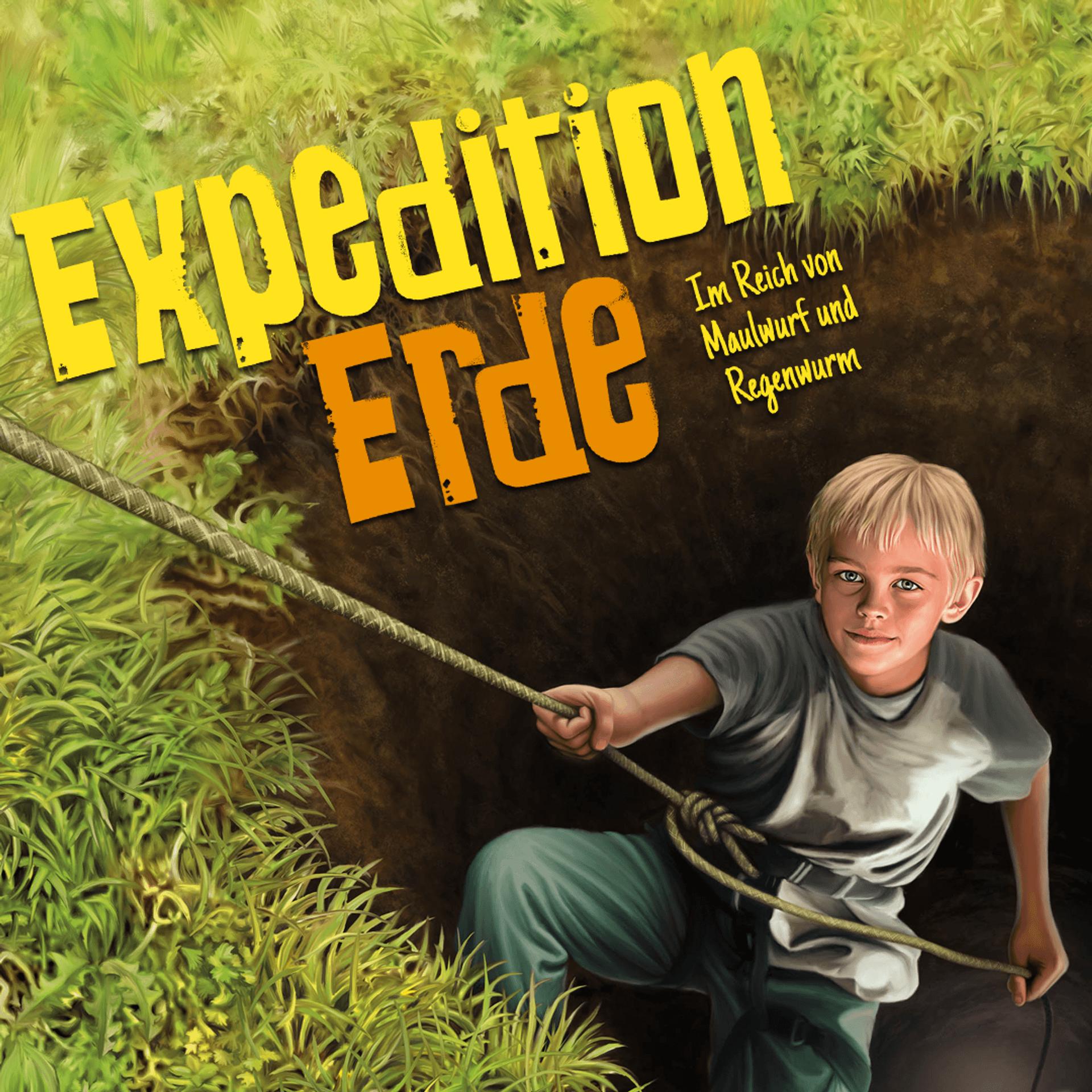 Junge hangelt sich an einem Seil aus einer Grube