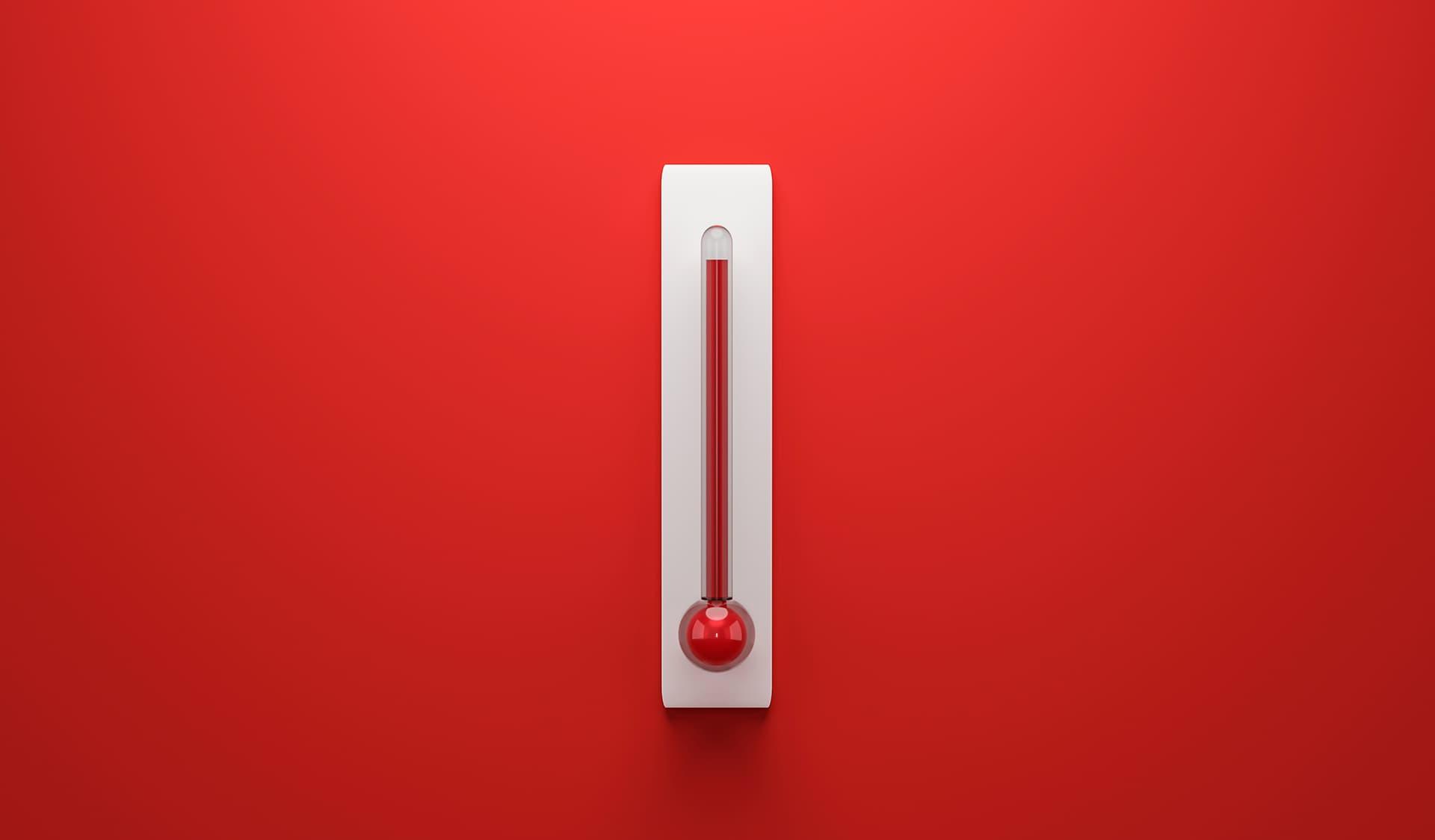 Thermometer mit Höchsttemperaturen vor rotem Hintergrund