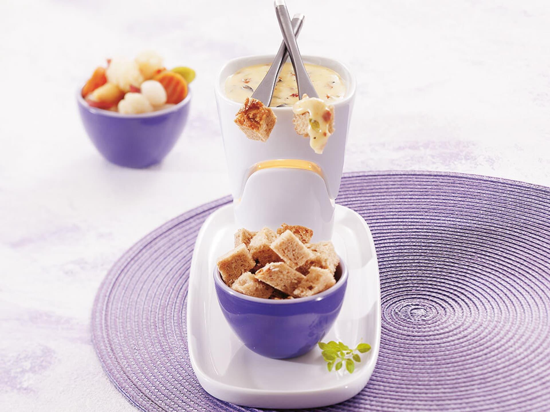 Käsefondue mit Oliven