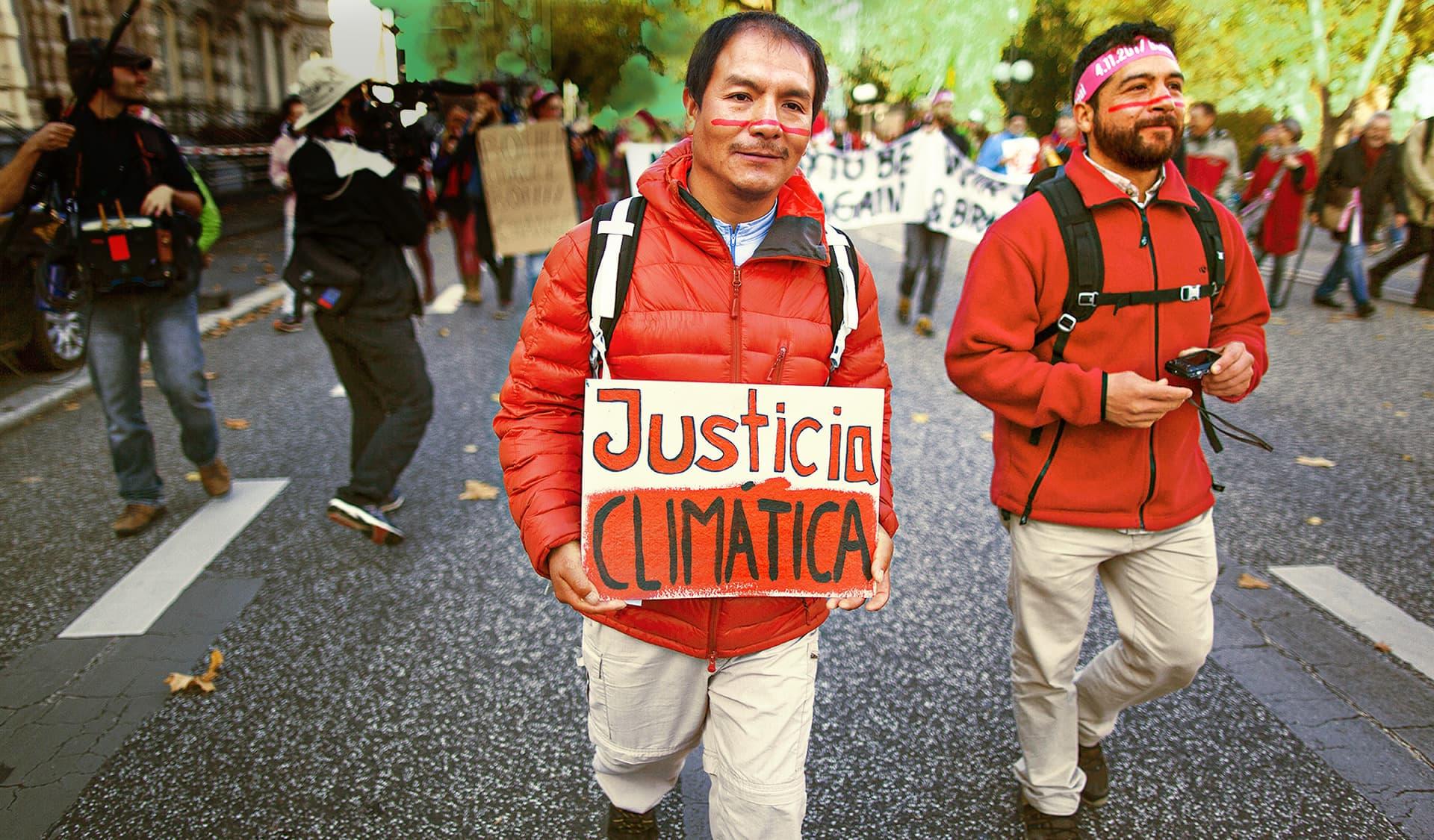 Demonstranten protestieren für Klimagerechtigkeit