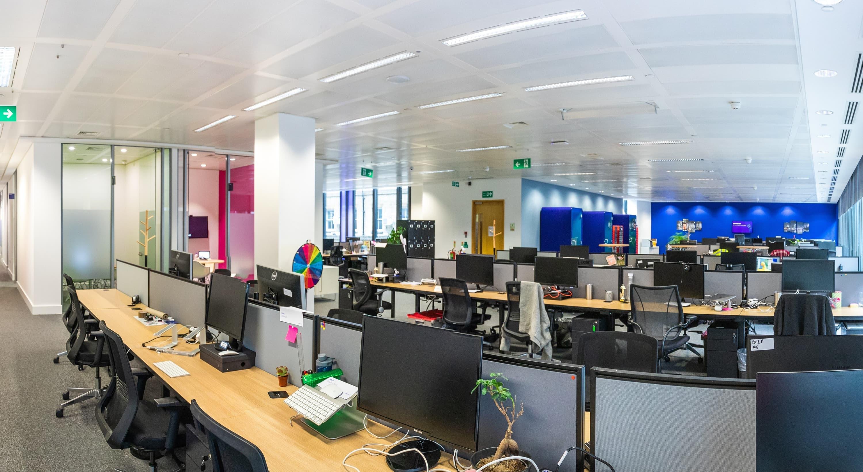 banks of empty desk in modern office