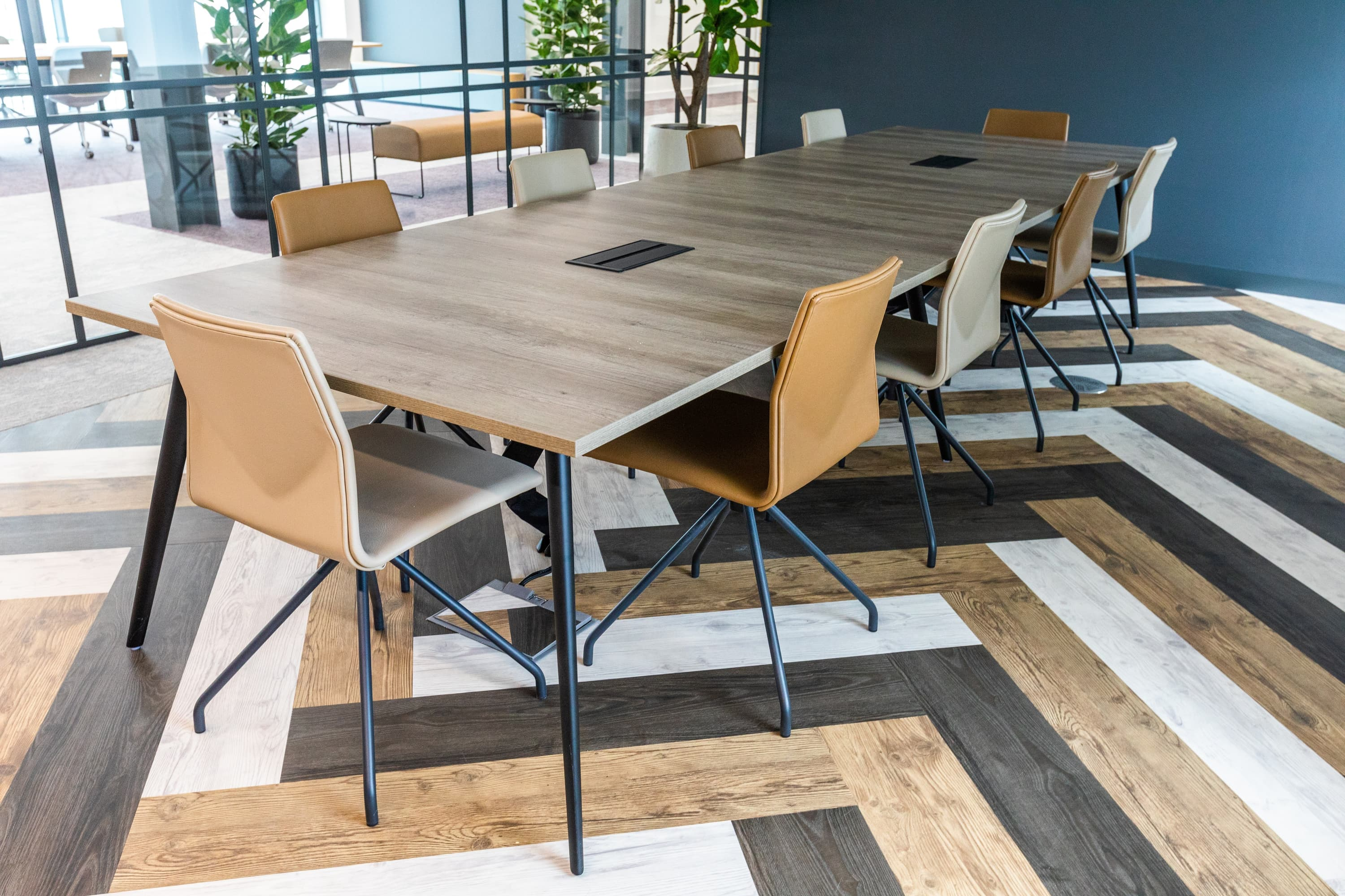 Meeting room with caramel chairs and patterned wooden floor